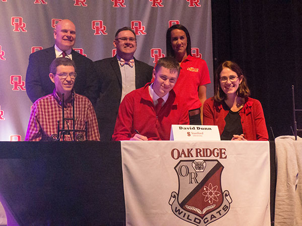 As family members and school and rowing officials look on, Oak Ridge senior David Dunn signs to row at Stanford University at Oak Ridge High School on Wednesday, Feb. 1, 2017. (Photo by John Huotari/Oak Ridge Today)