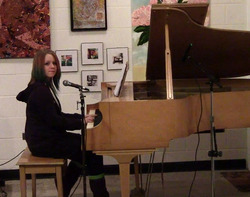 a picture of Skye Trull playing piano and singing for the Showcase of Original Music