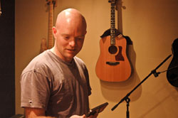 Musician singer songwriter Mike Garrigan in Two Egrets Media & Recording Studio