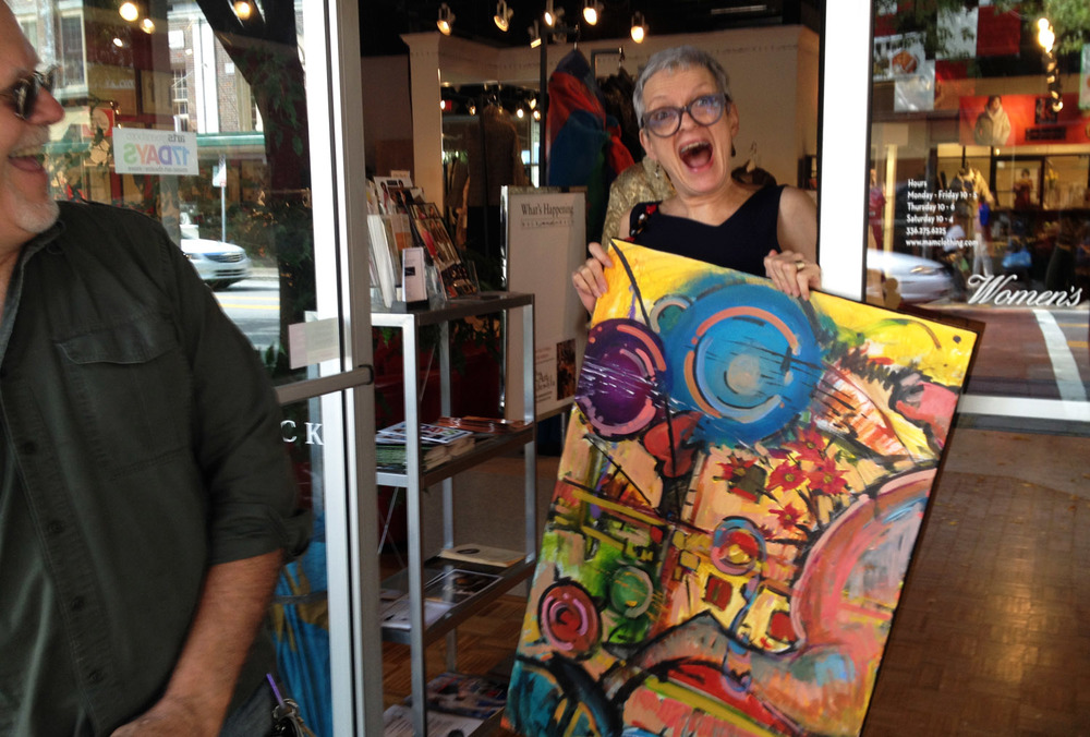 robin-davis-wins-one-of-the-abstract-paintings-in-the-collabative-raffle.JPG