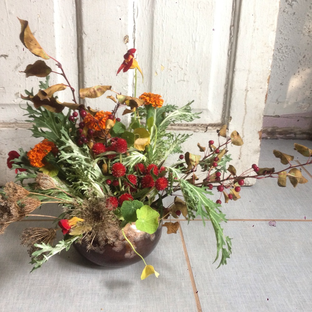 gomphrena, nasturtium, flowering kale, and queen ann's lace seed pod heads in the kind of pottery i grew up with