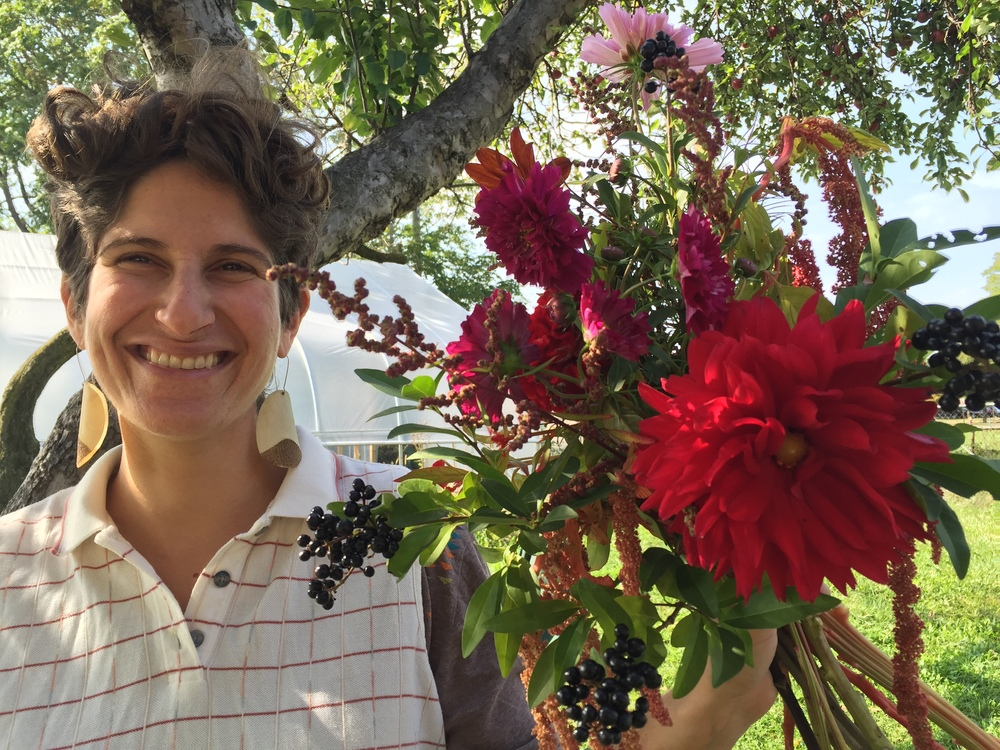 Farmer Sarah holding one of the last weekly bouquets of 2015. Luscious with dahlia, privet berries, trailing amaranth, double-click cosmos, and lambsquarter seed heads.