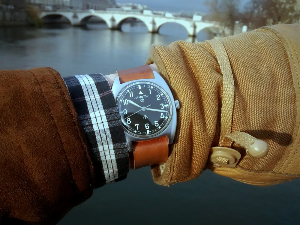 Hamilton W10 overlooking the pont du Carrousel above the river Seine in Paris.  The watch is worn on a one-piece Whiskey.