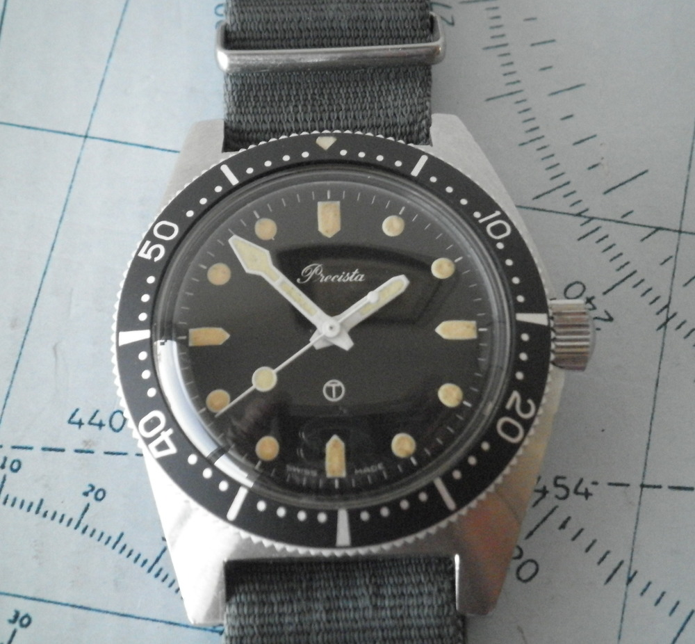 "1982 Precista Royal Navy diver.  Note the circle T.  Image       0   0   1   1   Rover Haven Uhren Werke   1   1   1   14.0         96   800x600               Normal   0           false   false   false     EN-US   JA   X-NONE                                                                                                                                                                                                                                                                                                                                                                            /* Style Definitions */ table.MsoNormalTable 	{mso-style-name:""Table Normal""; 	mso-tstyle-rowband-size:0; 	mso-tstyle-colband-size:0; 	mso-style-noshow:yes; 	mso-style-priority:99; 	mso-style-parent:""""; 	mso-padding-alt:0in 5.4pt 0in 5.4pt; 	mso-para-margin:0in; 	mso-para-margin-bottom:.0001pt; 	mso-pagination:widow-orphan; 	font-size:10.0pt; 	font-family:Calibri;}       ©   Terry Andrews."