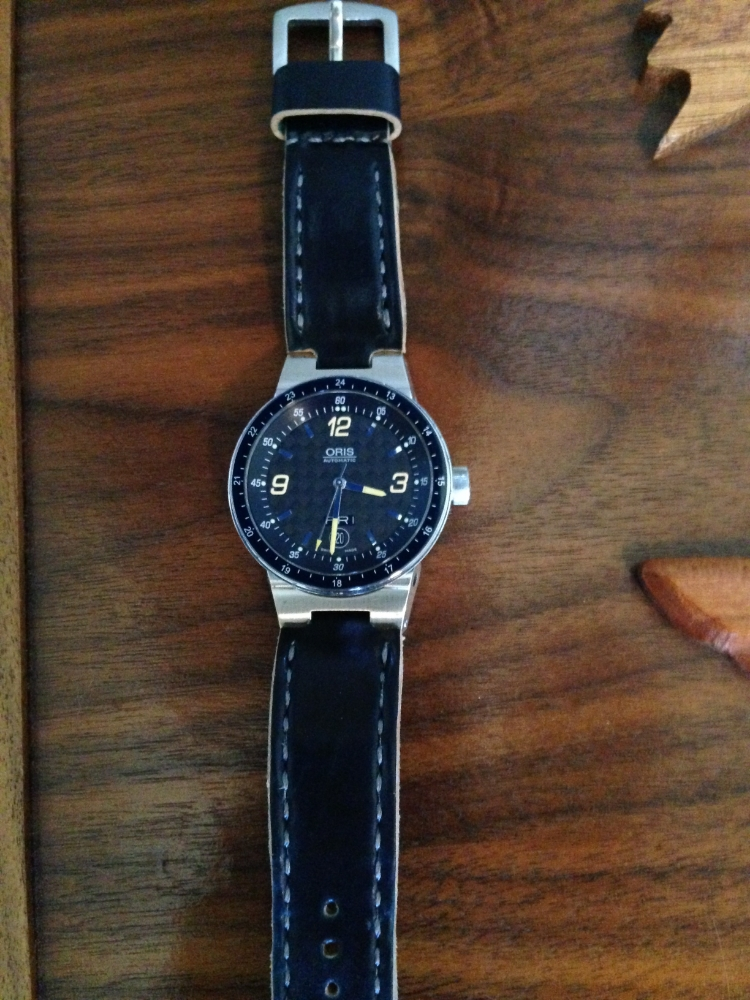 Oris F1 on Navy Arts & Crafts with gray stitching.  A very cool way to wear this otherwise bracelet-only Oris.