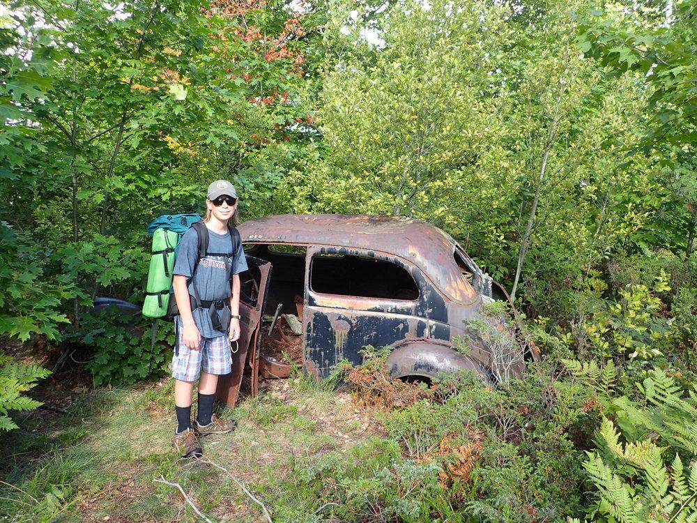 The remains of a 1937 Ford Tudor Humpback Sedan.