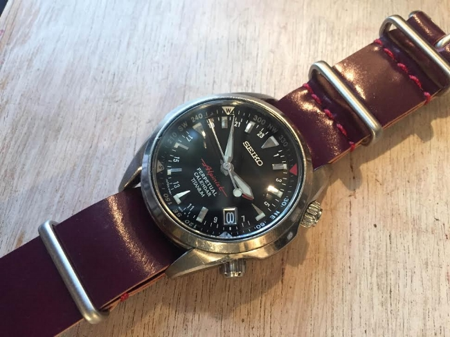 Seiko Alpinist Ti on a Cherry MIL strap with cranberry stitching.  Super fetching combo.