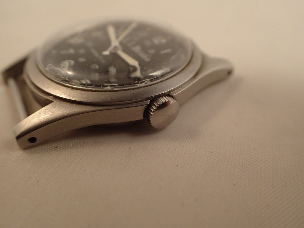 The Hamilton 9415 LL Bean Field Watch. Note the drilled lugs and thinner case. Crown can be signed or unsigned.