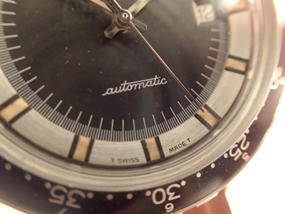 "The über-cool ""automatic"" dial detail.  I love this."