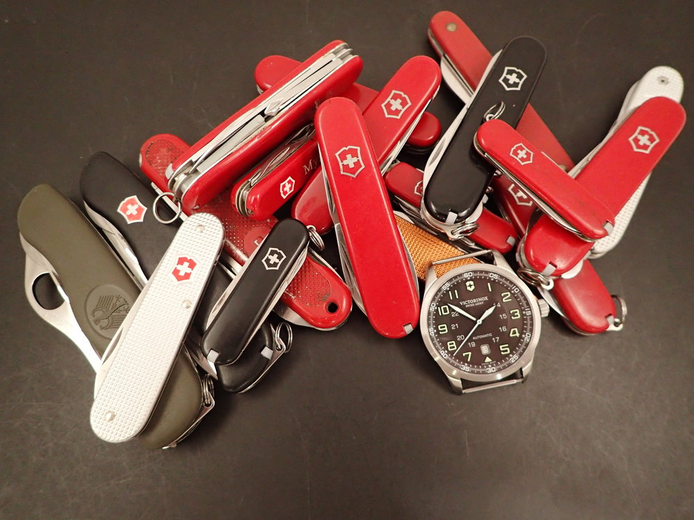 A lifetime's accumulation of Victorinox products.  Admit it, you have a pile like this too.