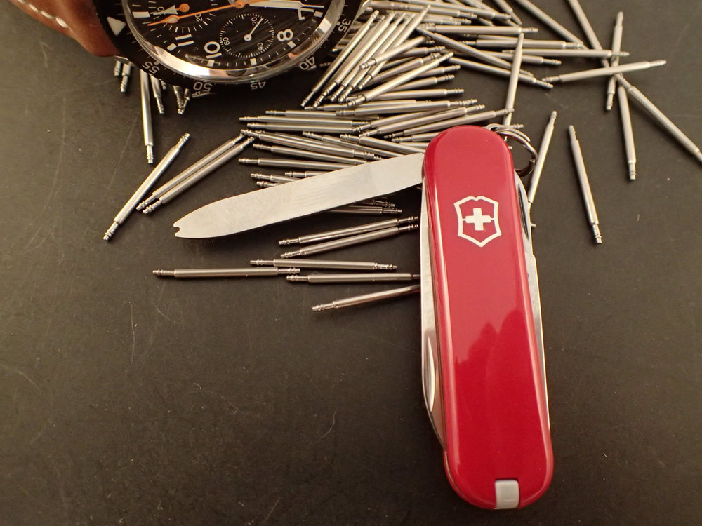 A rare Victorinox Classic with watch strap changing implement.