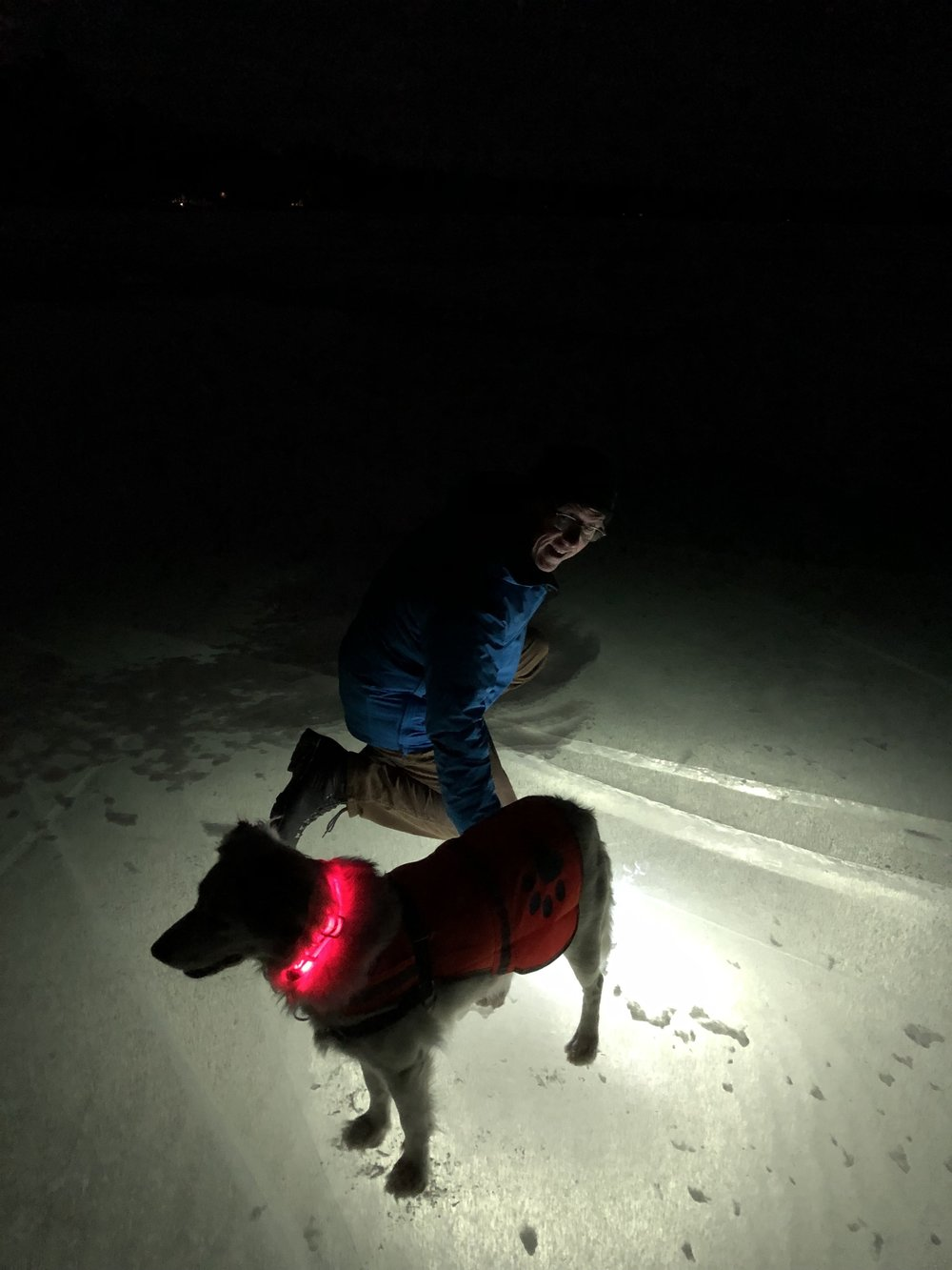 Shining an LED flashlight into the ice reveals its thickness.