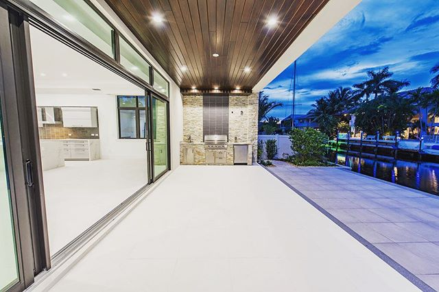 Outdoor covered patio with built-in BBQ. Gorgeous select grade Cyprus ceiling for that nice modern touch! #new #construction #custom #modern #contemporary #design #builder #realestate #soflo #boca #homeforsale