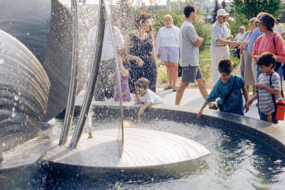 Children play in fountain