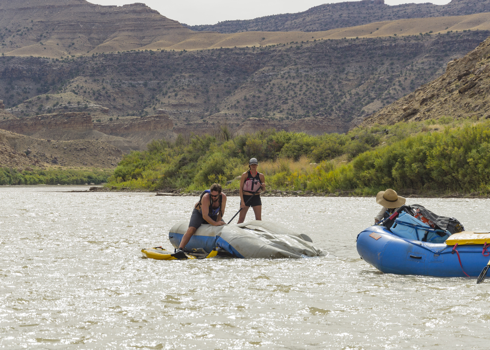 Flipped raft being recovered on the Green River, Utah.  Photo by Taylor Reilly, 2016.