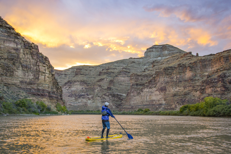 Standup paddleboarder during sunset in Desolation Canyon along the Green River, Utah. Photo by Taylor Reilly, 2016.