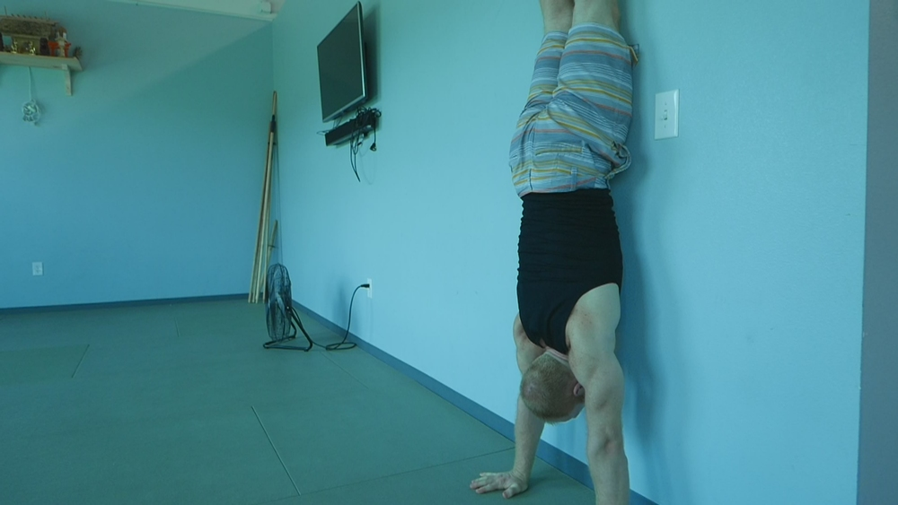 Upper Chest touching the wall