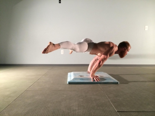 Shoulders past the hands to counterbalance the legs.