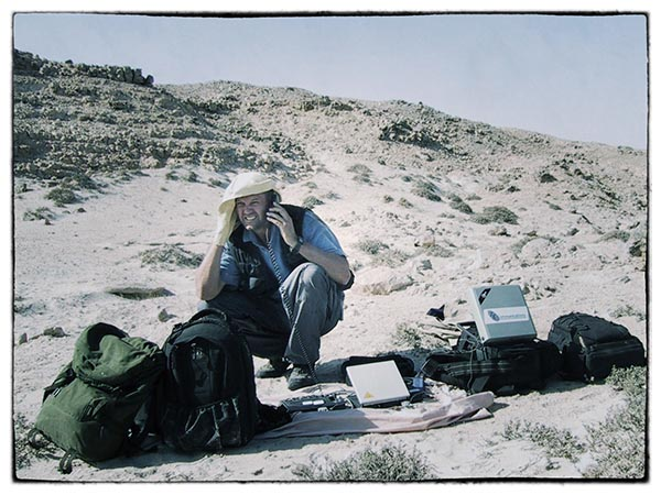 Filing via satellite. Oman 2001.