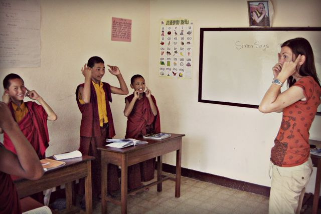 Teaching English to young monks through Simon Says games at a monastery in Nepal