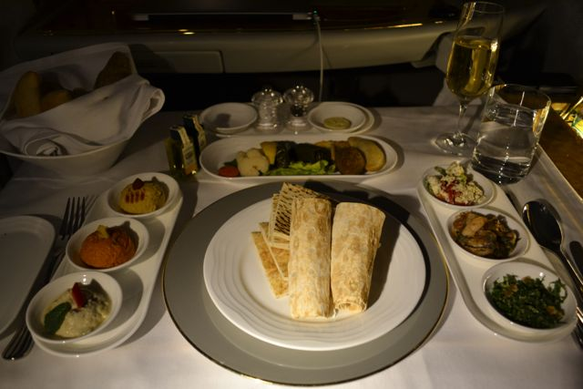 It started to get dark on the plane (with dimmed lighting) so we don't have great food pics. This is a shot of the traditional middle eastern mezze appetizer that we ordered. I know, huge.