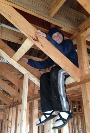 """John Patrick checking out the new framing in the """"boy's room""""."""