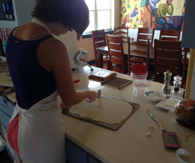 The new AHOP intern preparing to bake communion bread for her family's church