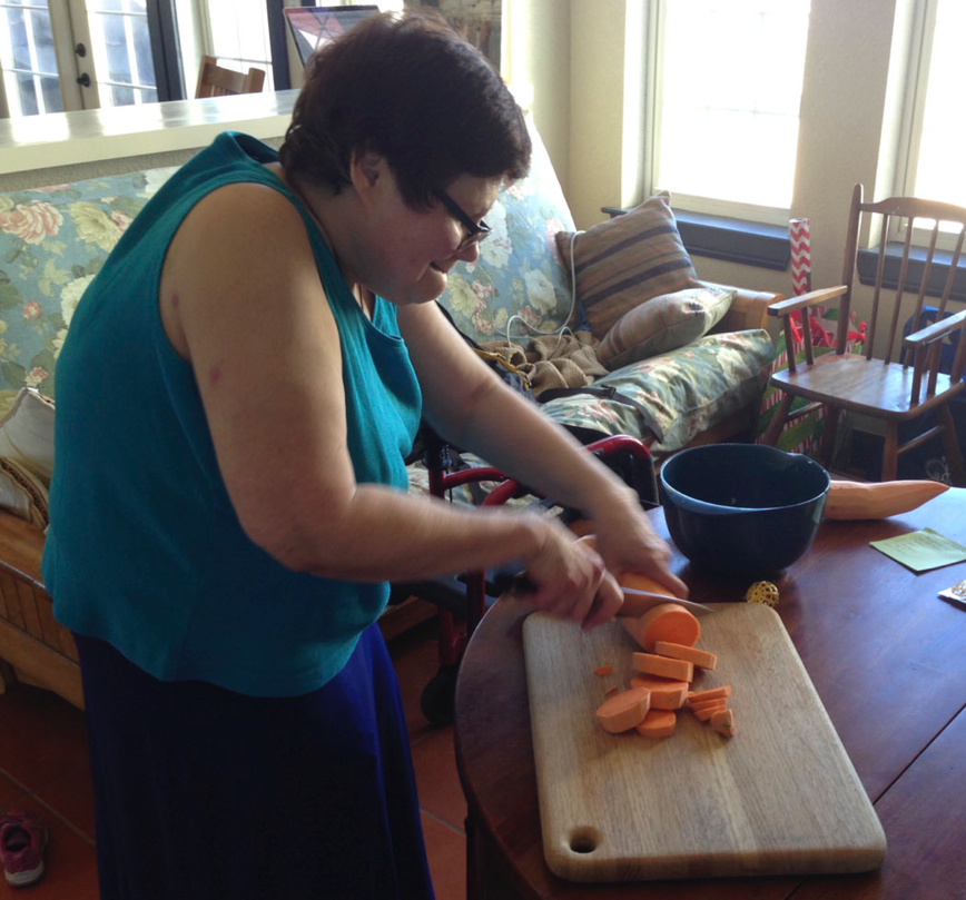Geri cutting sweet potatoes in preparation for Thanksgiving