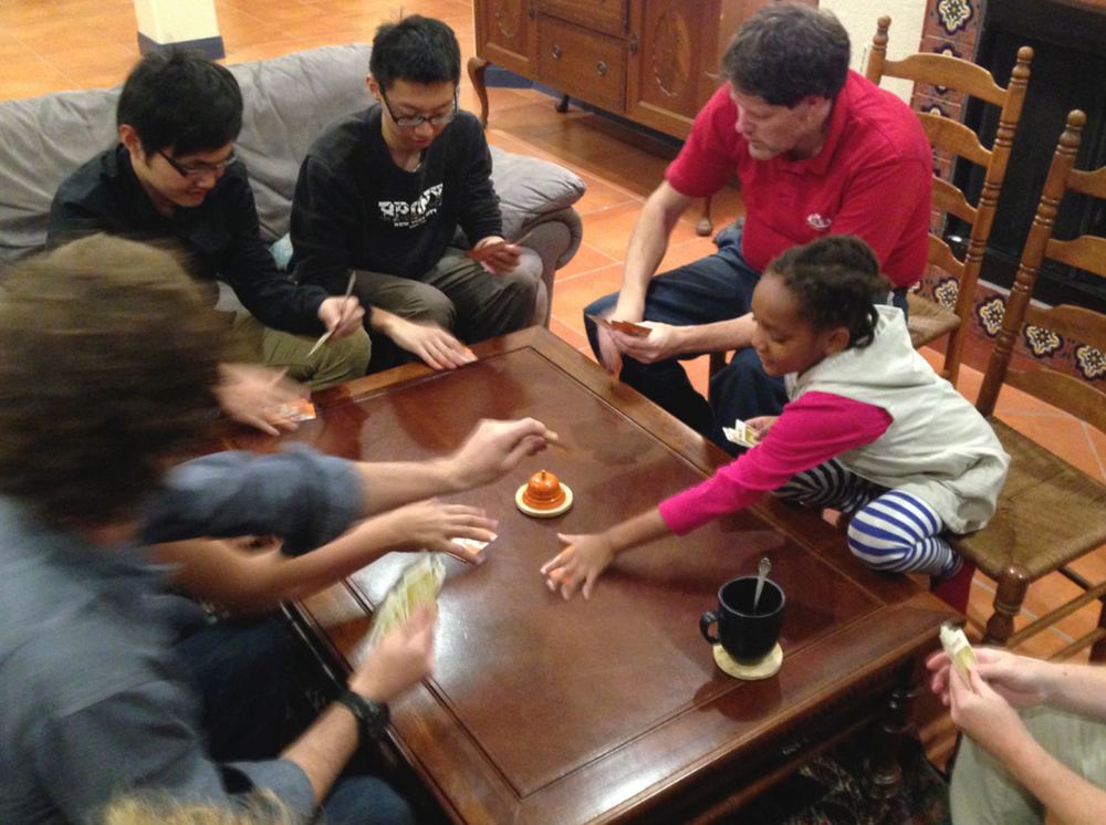 Our friend Mark invited two young Chinese students to join us for Thanksgiving dinner ... here we are introducing them to the game Pit