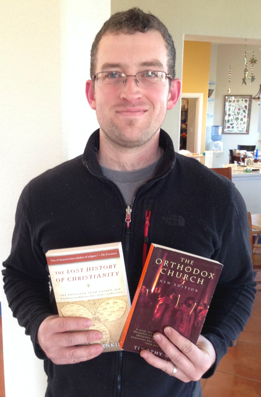 Michael checking out two books about the Eastern church, to help prepare for Dr. Andrew Jackson's visit on Feb. 21.
