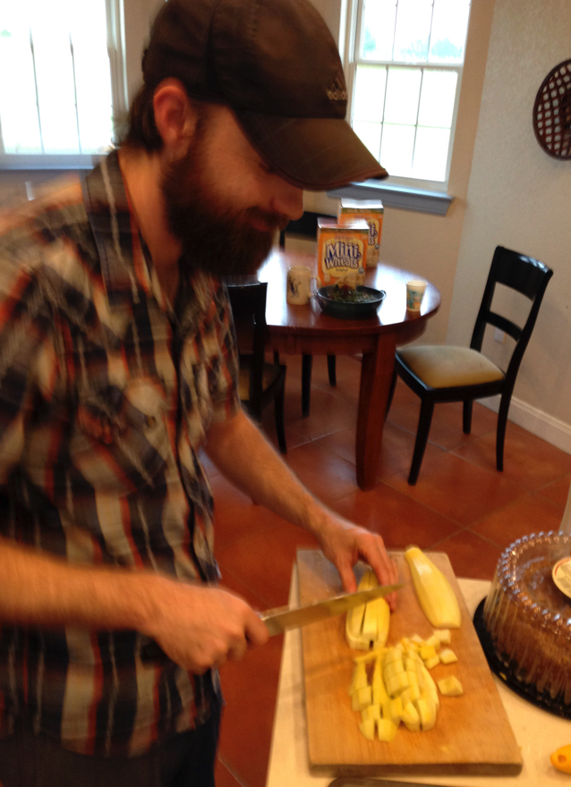 Mark preparing potatoes before the August community dinner, following our retreat & prayer time.