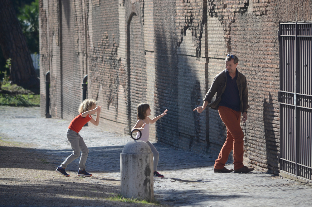 Family playing red light, green light outside the Diocletian Baths in Rome