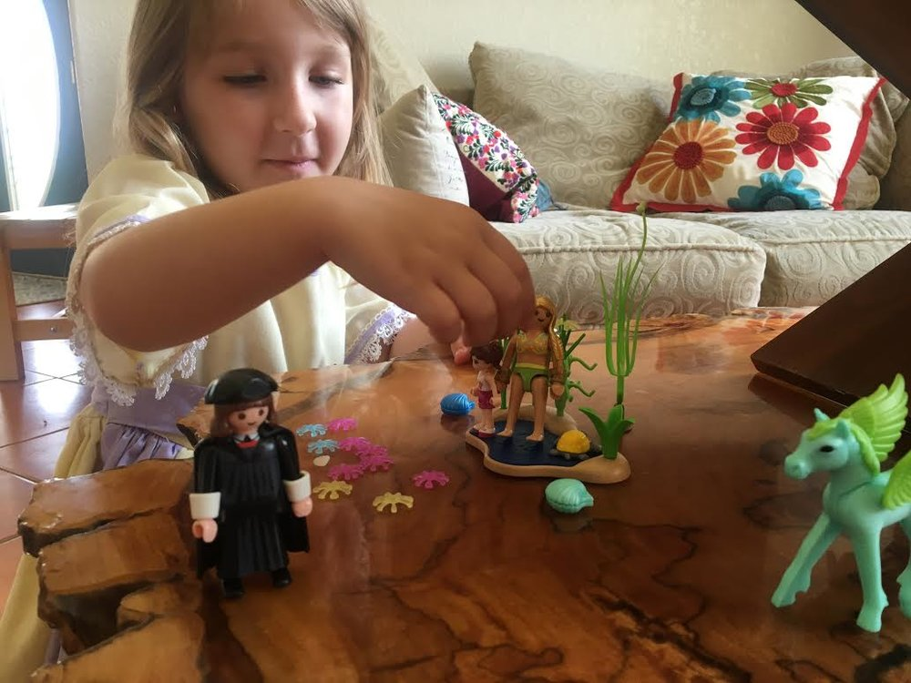 Clara introduces Martin Luther to a water fairy.
