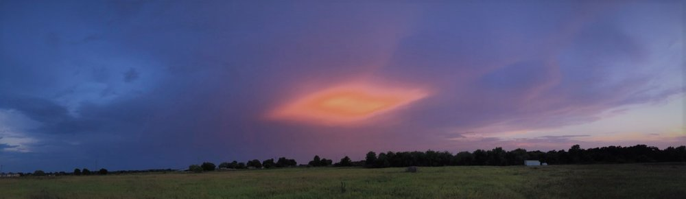 "This glowing cloud in the sky was the climax of a spectacular light show one evening here at CTR. It reminded us of the ""door standing open in heaven"" which John saw in Revelation.  Sadly, we could not pass through this door. Someday we shall see what John saw."