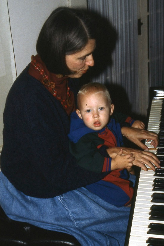Grannie Annie playing piano with Noah.