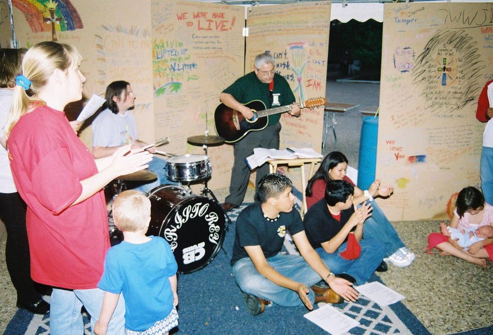 The Cristo Rey Catholic youth group taking a night prayer session in the UT Rez Week 24/7 prayer tent in 2003.