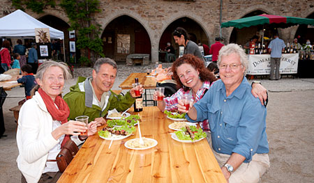 From left to right: Véronique, Thomas, Heather and Patrick, having a lot of fun, enjoying life at the Sauveterre-de-Rouergue producers' market.