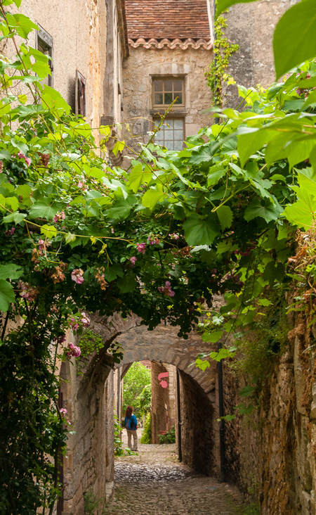 """Heather wandering in Saint-Cirq Lapopie, voted in 2012 """"The Preferred Village By The French""""."""