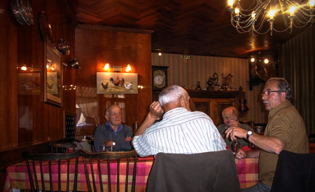 At Rignac, some locals having a lively conversation around some wine in a typical restaurant.