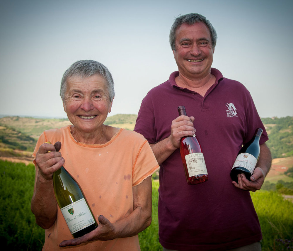 The Marcillac winemakers Philippe Teullier and his mother proudly showing us a bottle of red, rosé and white tehy produce on their domain.