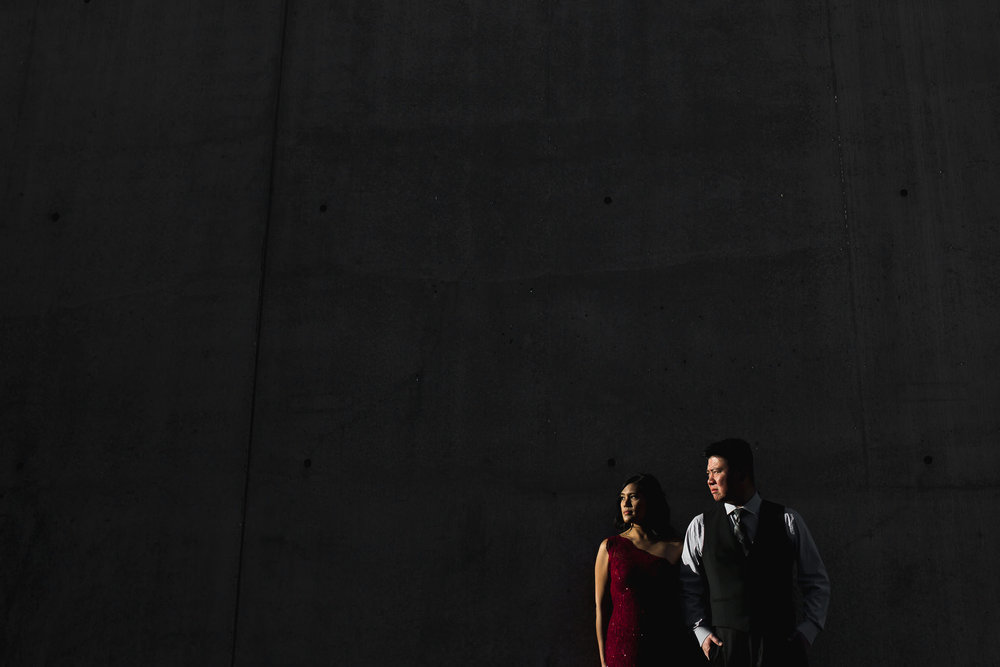 Found a sliver of sun light that would light the couple and not the wall. Made for a really cool and contrasty image!