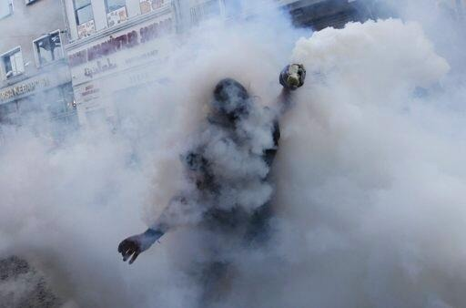 Tear gas bombs thrown by police at Turkish rebels.