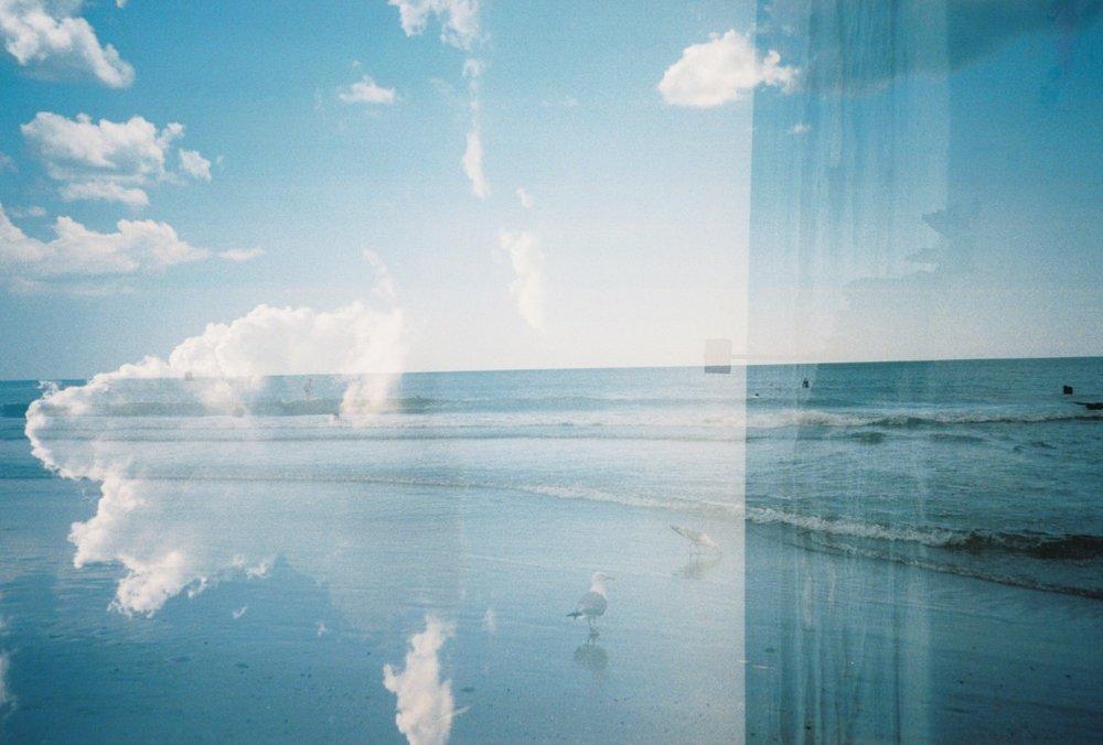 "sunbake :     ""vertical horizon""   seagulls + clouds + ocean   rockaway beach, ny"