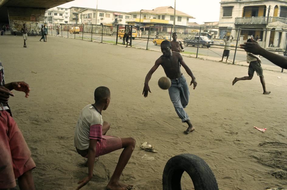dynamicafrica :     Street football match in Lagos, Nigeria.   1997