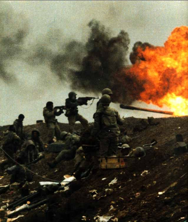 simply-war :     Iranian soldiers in the battlefield firing towards Iraqi soldiers.