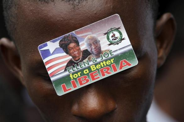 "npr :      kilele :     An image of Ellen Johnson-Sirleaf (L), current Liberian president,  presidential candidate for the United Party (UP) and Nobel laureate, and  Vice President Joseph N. Boakai is seen on the forehead of a supporter  in Monrovia October 9, 2011.       Photo by REUTERS/Luc Gnago      Reuters reports this morning that the election is "" under cloud after boycott ."" —Wright"