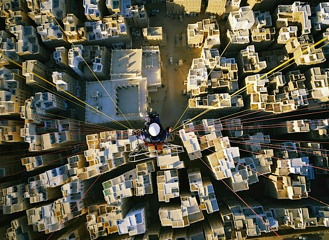 a great way to see the city -    photojojo :      Aerial  photographer extraordinaire George Steinmetz ,piloting a  motorized paraglider over Shibam, Yemen.    This post is by  Kateoplis  as part of Photojojo's  Show & Tell week .