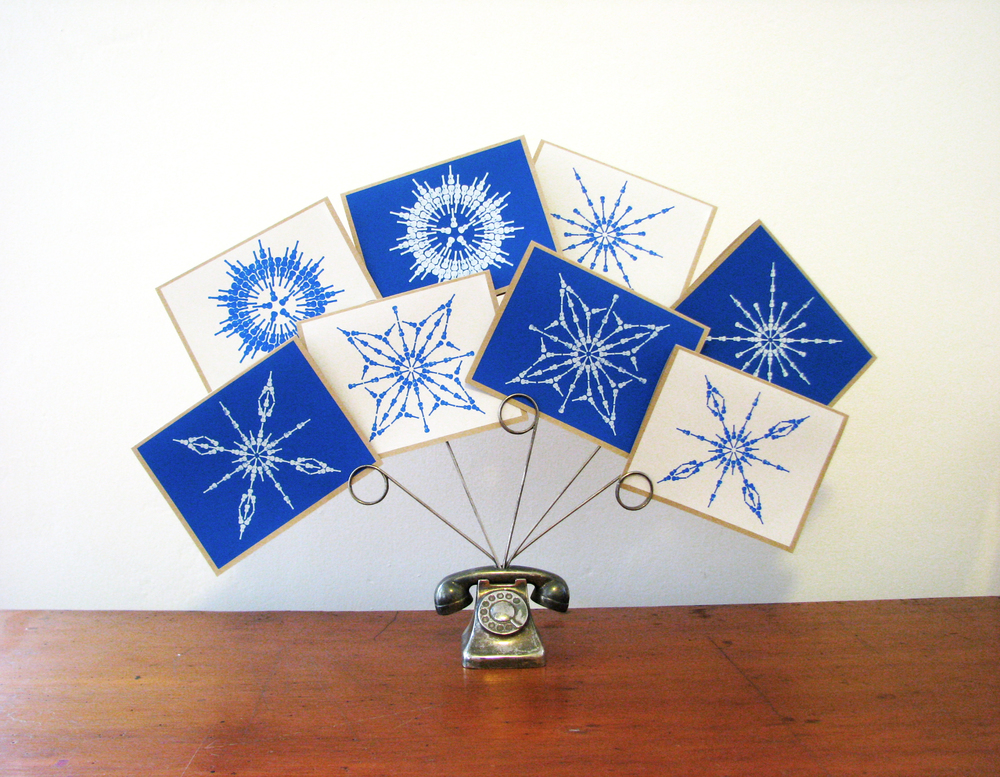 We have a set of 8 hand screen printed snow flakes made entirely of ukuleles! Not one is the same! You still have time to order your cards and get them out for the holidays!