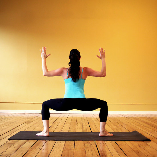 Directions: Stand at the front of your yoga mat and step out, opening your legs about three feet apart. Bend your knees into a squat position, with your knees directly over your ankles. Lift your arms, bending your elbows at 90 degree angles with your palms facing away from you. Hold this pose for five deep breaths.
