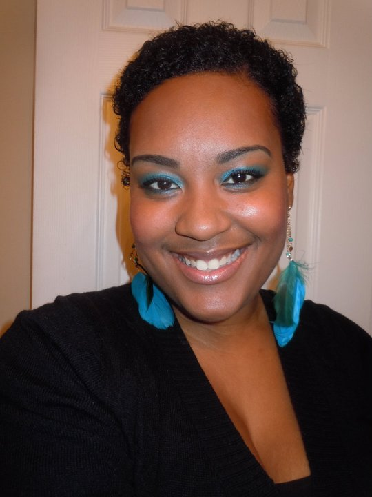 I tried to transition but I hated having half curly, half straight hair...not cute! So, I bought a few products, including a pair of hair scissors and I did my big chop in my upstairs bathroom on April 13, 2011. I fell completely in love with my hair.